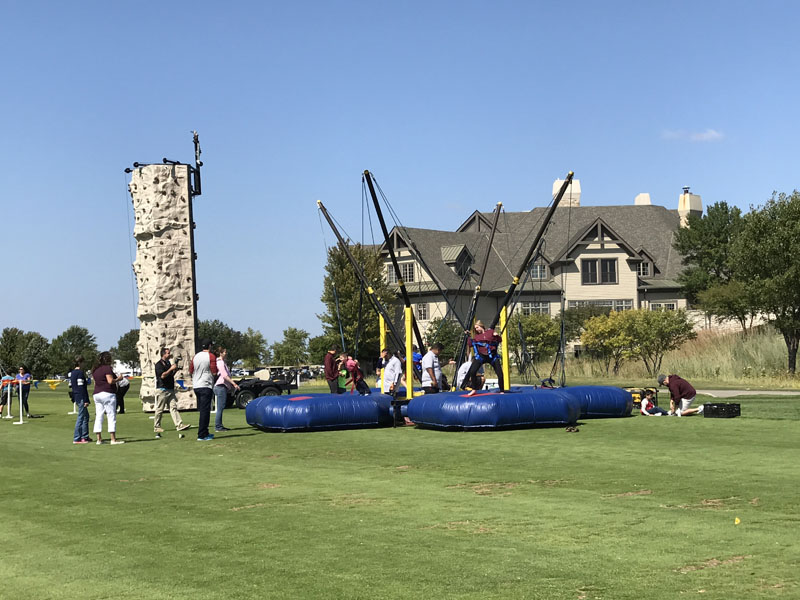 A jumpie and climbing wall set up for a birthday party at Bolingbrook Golf Club
